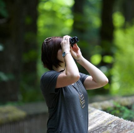 lady looking through binoculars