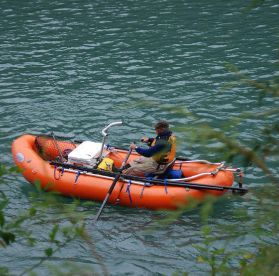 man in row boat on water in Mike Gurling National Park