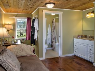 Cedar Creek Room with sofa, sink, bathroom